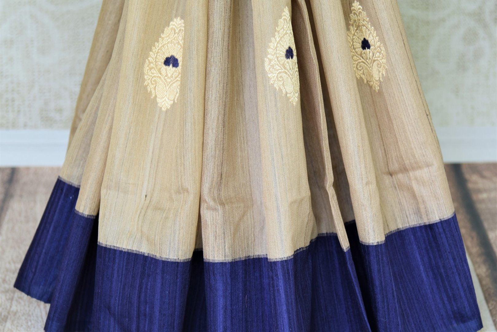 Buy cream Banarasi silk saree online in USA with blue border and zari buta. Give your Indian look an extra style edge with beautiful Indian designer saris available at Pure Elegance Indian clothing store in USA or shop online.-pleats