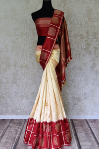 Off-white Banarasi silk saree with red zari buta border buy online in USA. Adorn your style with a range of exquisite handloom sarees from Pure Elegance Indian clothing store in USA. We have an exquisite range of Indian designer sarees, silk sarees, Banarasi saris and many other varieties also available at our online store.-full view