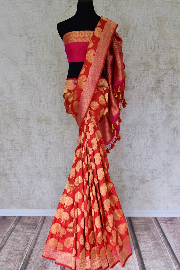 Shop red Banarasi silk saree with marigold flower buta online in USA. You can find a fine collection of Indian designer sarees in USA at Pure Elegance clothing store. Our range of traditional Indian clothing, silk sarees, wedding sarees,  at our online store is sure to leave you awestruck. -full view