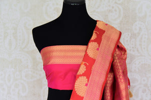 Shop red Banarasi silk saree with marigold flower buta online in USA. You can find a fine collection of Indian designer sarees in USA at Pure Elegance clothing store. Our range of traditional Indian clothing, silk sarees, wedding sarees,  at our online store is sure to leave you awestruck. -blouse pallu
