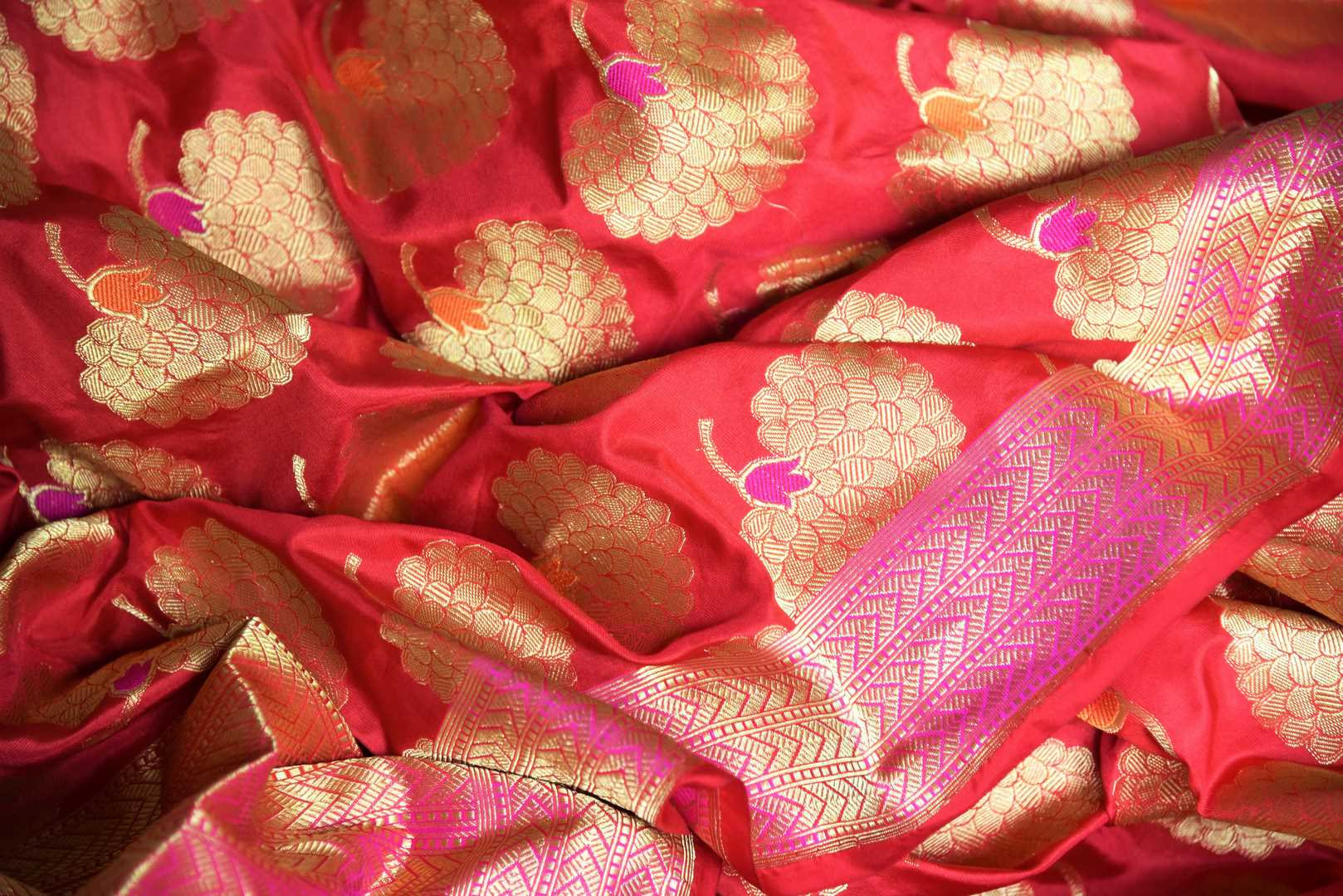 Shop red Banarasi silk saree with marigold flower buta online in USA. You can find a fine collection of Indian designer sarees in USA at Pure Elegance clothing store. Our range of traditional Indian clothing, silk sarees, wedding sarees,  at our online store is sure to leave you awestruck. -details