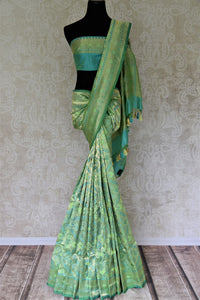 Shop green Banarasi silk saree online in USA with overall zari work. Give your Indian look an extra style edge with beautiful Indian designer silk sarees available at Pure Elegance Indian clothing store in USA or shop online.-full view