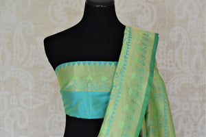 Shop green Banarasi silk saree online in USA with overall zari work. Give your Indian look an extra style edge with beautiful Indian designer silk sarees available at Pure Elegance Indian clothing store in USA or shop online.-blouse pallu
