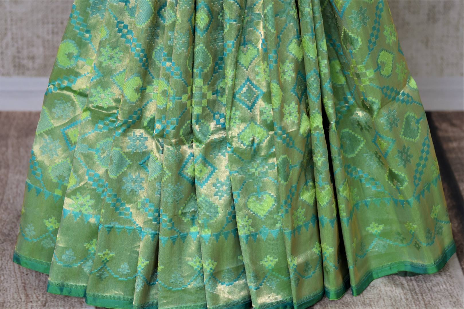 Shop green Banarasi silk saree online in USA with overall zari work. Give your Indian look an extra style edge with beautiful Indian designer silk sarees available at Pure Elegance Indian clothing store in USA or shop online.-pleats
