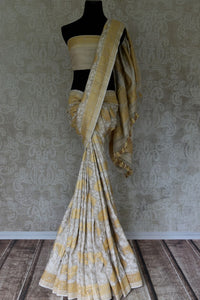Buy elegant off-white khaddi Banarasi saree with zari border online in USA. Adorn your style with a range of exquisite handwoven sarees from Pure Elegance Indian clothing store in USA. We have an exquisite range of Indian designer sarees, silk saris, Banarasi saris and many other varieties also available at our online store.-full view