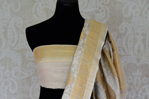 Buy elegant off-white khaddi Banarasi saree with zari border online in USA. Adorn your style with a range of exquisite handwoven sarees from Pure Elegance Indian clothing store in USA. We have an exquisite range of Indian designer sarees, silk saris, Banarasi saris and many other varieties also available at our online store.-blouse pallu