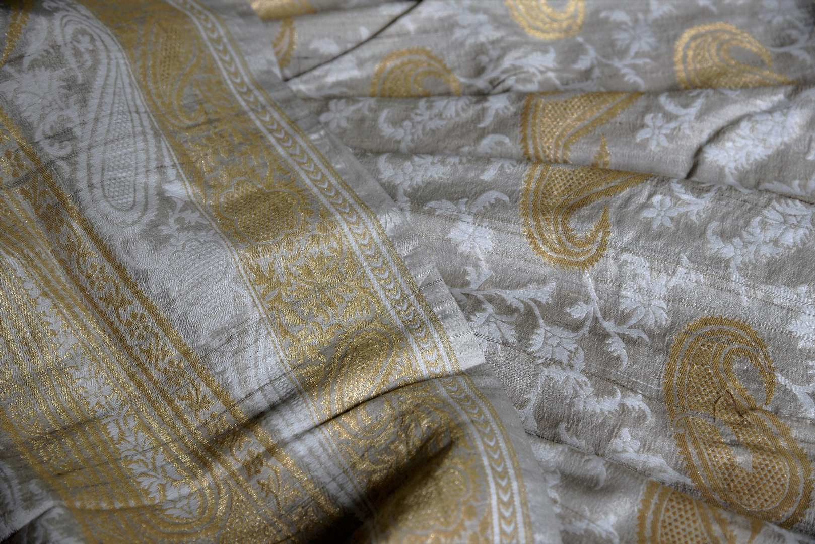 Buy elegant off-white khaddi Banarasi saree with zari border online in USA. Adorn your style with a range of exquisite handwoven sarees from Pure Elegance Indian clothing store in USA. We have an exquisite range of Indian designer sarees, silk saris, Banarasi saris and many other varieties also available at our online store.-details