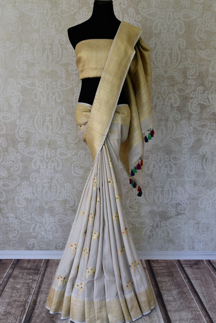 Buy off-white khaddi silk saree with zari tree buta online in USA. Adorn your style with a range of exquisite handwoven sarees from Pure Elegance Indian clothing store in USA. We have an exquisite range of Indian designer sarees, silk saris, Banarasi saris and many other varieties also available at our online store.-full view