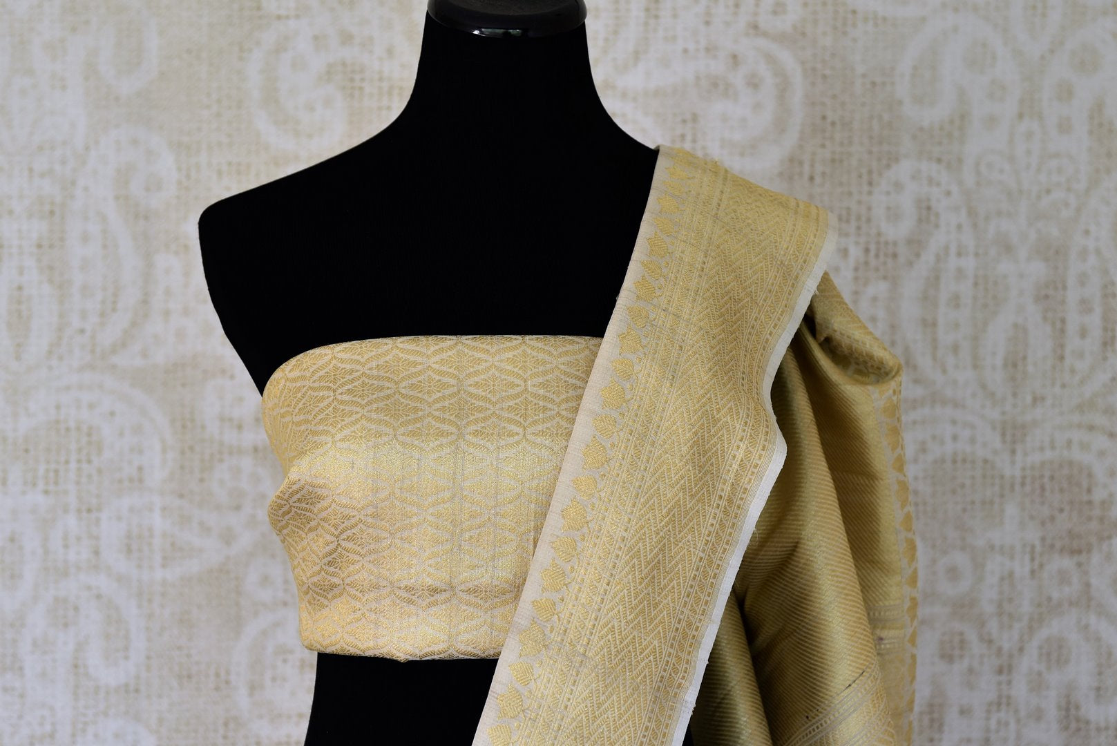 Buy off-white khaddi silk saree with zari tree buta online in USA. Adorn your style with a range of exquisite handwoven sarees from Pure Elegance Indian clothing store in USA. We have an exquisite range of Indian designer sarees, silk saris, Banarasi saris and many other varieties also available at our online store.-blouse pallu
