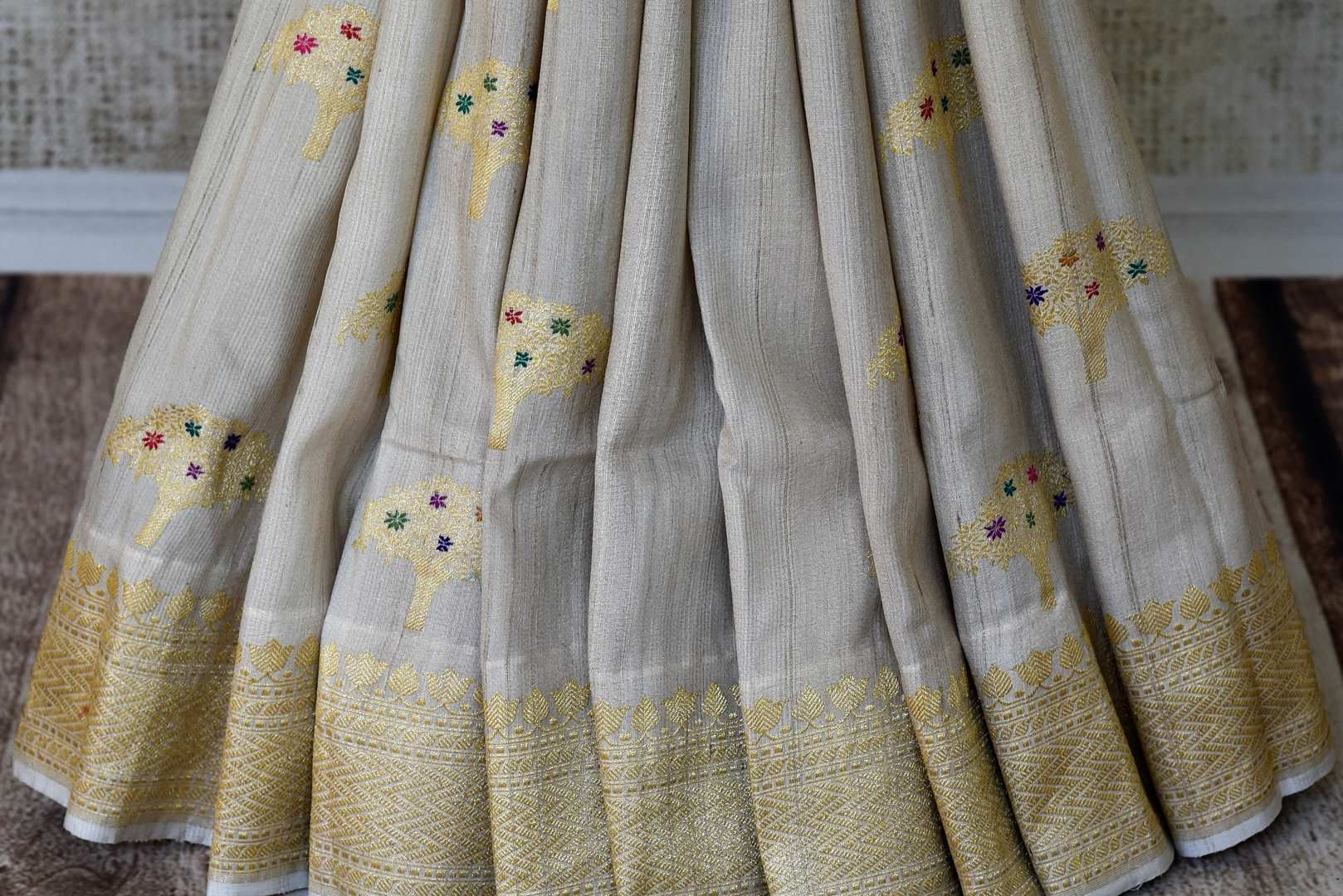 Buy off-white khaddi silk saree with zari tree buta online in USA. Adorn your style with a range of exquisite handwoven sarees from Pure Elegance Indian clothing store in USA. We have an exquisite range of Indian designer sarees, silk saris, Banarasi saris and many other varieties also available at our online store.-pleats