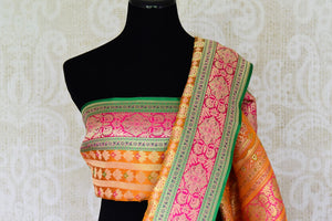 The ostentatious yet rich orange banarsi silk sari is a perfect pick for social events, parties etc. Style it with a stunning orange designer blouse. It features rich buta work all-over the drape. Shop designer silk sari, chiffon saree, embroidered sari online or visit Pure Elegance store, USA. -blouse pallu