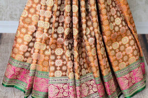 The ostentatious yet rich orange banarsi silk sari is a perfect pick for social events, parties etc. Style it with a stunning orange designer blouse. It features rich buta work all-over the drape. Shop designer silk sari, chiffon saree, embroidered sari online or visit Pure Elegance store, USA. -pleats