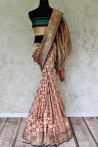 Set those eyes on you in this gorgeous brown banarsi silk designer sari. It features a stunning floral zari border with zari work that further enhances the richness of this sari. Style it with a designer blouse. Shop handcrafted silk sarees, georgette sari, linen sari online or visit Pure Elegance store, USA. -full view