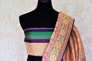 Set those eyes on you in this gorgeous brown banarsi silk designer sari. It features a stunning floral zari border with zari work that further enhances the richness of this sari. Style it with a designer blouse. Shop handcrafted silk sarees, georgette sari, linen sari online or visit Pure Elegance store, USA. -blouse pallu