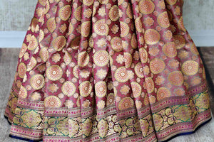 Set those eyes on you in this gorgeous brown banarsi silk designer sari. It features a stunning floral zari border with zari work that further enhances the richness of this sari. Style it with a designer blouse. Shop handcrafted silk sarees, georgette sari, linen sari online or visit Pure Elegance store, USA. -pleats