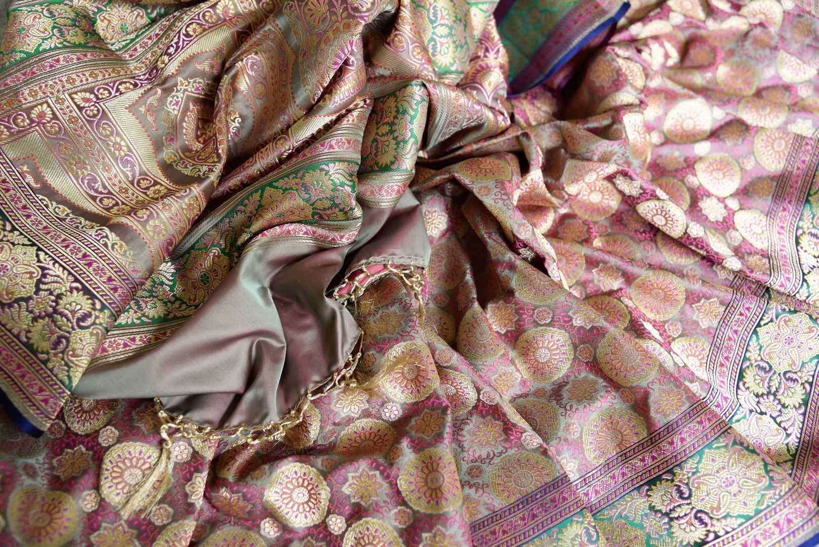 Set those eyes on you in this gorgeous brown banarsi silk designer sari. It features a stunning floral zari border with zari work that further enhances the richness of this sari. Style it with a designer blouse. Shop handcrafted silk sarees, georgette sari, linen sari online or visit Pure Elegance store, USA. -details