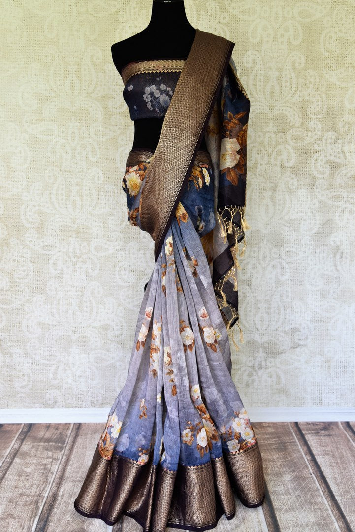 Emanate elegance in this blue chanderi silk organza sari. It features floral printed work which comes with a brown zari banarsi silk border. Style it with a designer blue floral printed blouse with a gold border. Shop such banarsi silk saris, embroidered sarees, kalamkari sari online or visit Pure Elegance store, USA.-full view