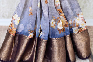 Emanate elegance in this blue chanderi silk organza sari. It features floral printed work which comes with a brown zari banarsi silk border. Style it with a designer blue floral printed blouse with a gold border. Shop such banarsi silk saris, embroidered sarees, kalamkari sari online or visit Pure Elegance store, USA.-pleats