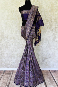 Emanate a flair of sophistication in this purple banarsi and tanchoi printed silk saree. The wonderful melange of colors and prints exude subtle sass. Style this saree with a plain purple blouse. Shop handloom sarees, banarsi silk sari, linen sari online or visit Pure Elegance store, USA.-full view