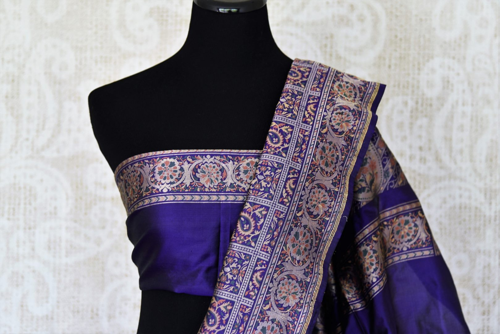 Emanate a flair of sophistication in this purple banarsi and tanchoi printed silk saree. The wonderful melange of colors and prints exude subtle sass. Style this saree with a plain purple blouse. Shop handloom sarees, banarsi silk sari, linen sari online or visit Pure Elegance store, USA.-blouse pallu