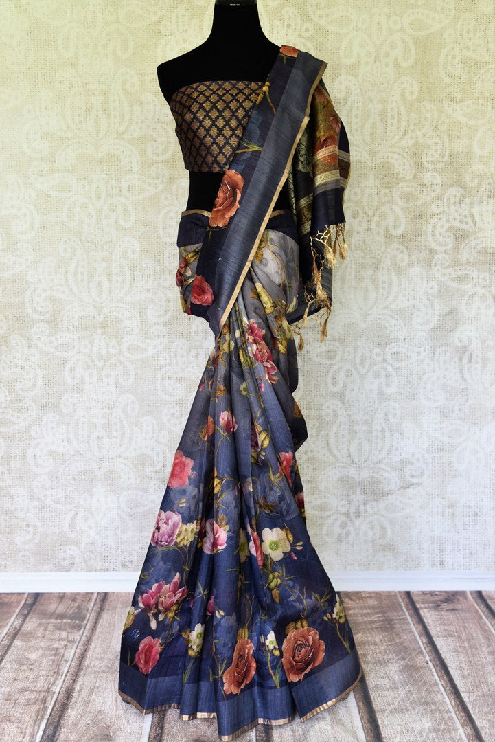 Up your avant-garde fashion taste with our black floral printed tussar silk banarsi saree. It comes with a gorgeous contrasting black and gold buta work blouse to turn heads. Shop banarsi silk sarees, ikkat sarees, kalamkari sari online or visit Pure Elegance store, USA.-full view
