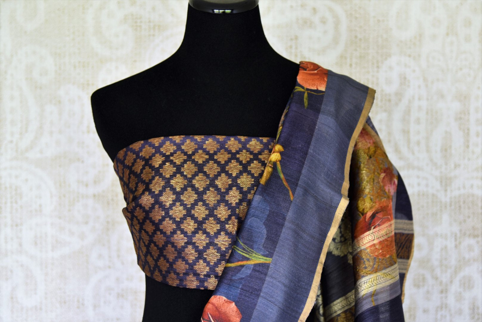 Up your avant-garde fashion taste with our black floral printed tussar silk banarsi saree. It comes with a gorgeous contrasting black and gold buta work blouse to turn heads. Shop banarsi silk sarees, ikkat sarees, kalamkari sari online or visit Pure Elegance store, USA.-blouse pallu