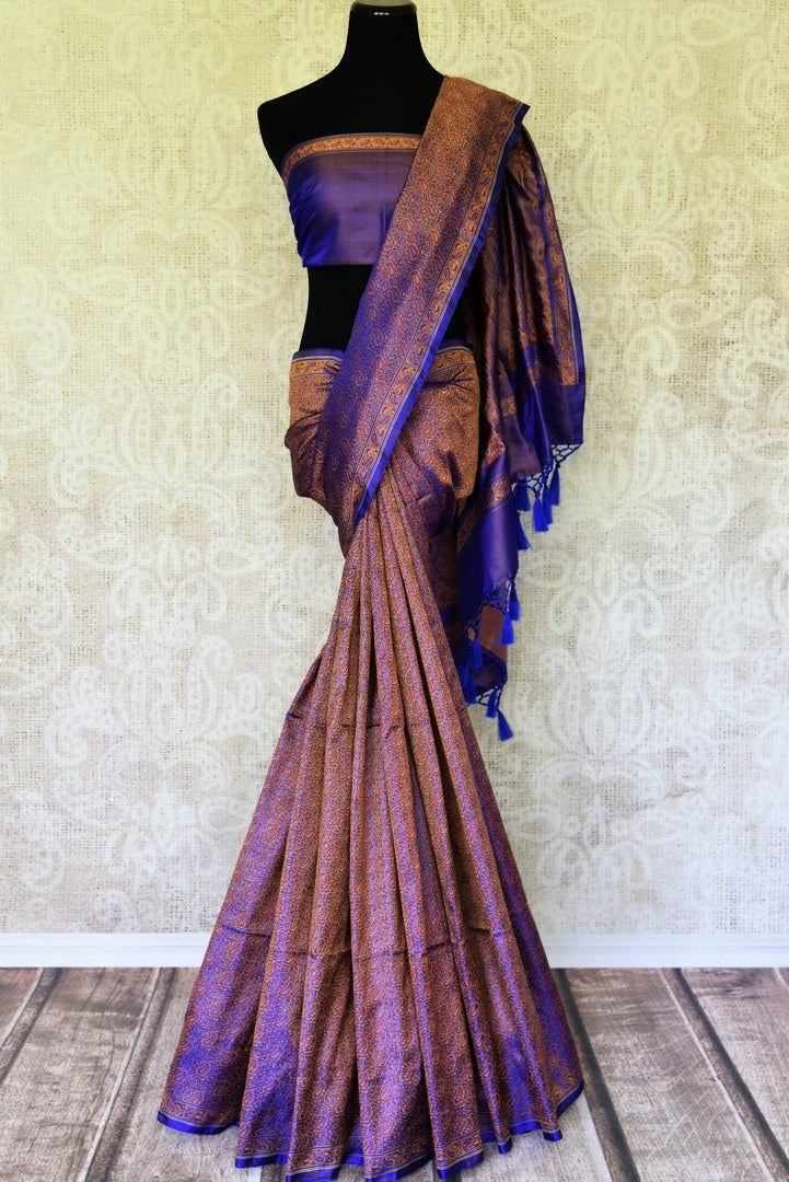 Rise and shine in this glorious royal blue banarsi silk saree with tanchoi print. Embrace the cultural ties in this party wear traditional Indian sari. Style it with a plain purple blouse and tanchoi detailing. Shop handloom sarees, kanjeevaram silk sari, printed saree online or visit Pure Elegance store, USA.-full view