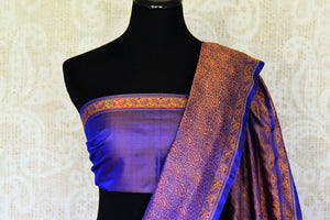 Rise and shine in this glorious royal blue banarsi silk saree with tanchoi print. Embrace the cultural ties in this party wear traditional Indian sari. Style it with a plain purple blouse and tanchoi detailing. Shop handloom sarees, kanjeevaram silk sari, printed saree online or visit Pure Elegance store, USA.-blouse pallu