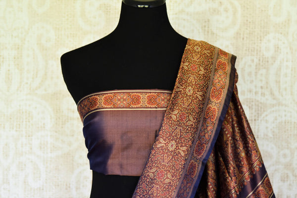 Elevate your fashion in this purple banarsi silk sari with intricate tanchoi detailing all-over. The sparkling designer saree comes with a plain purple blouse complemented with tanchoi detailing on the border. Shop handcrafted silk sarees, linen sari, chiffon sari online or visit Pure Elegance store, USA.-blouse pallu