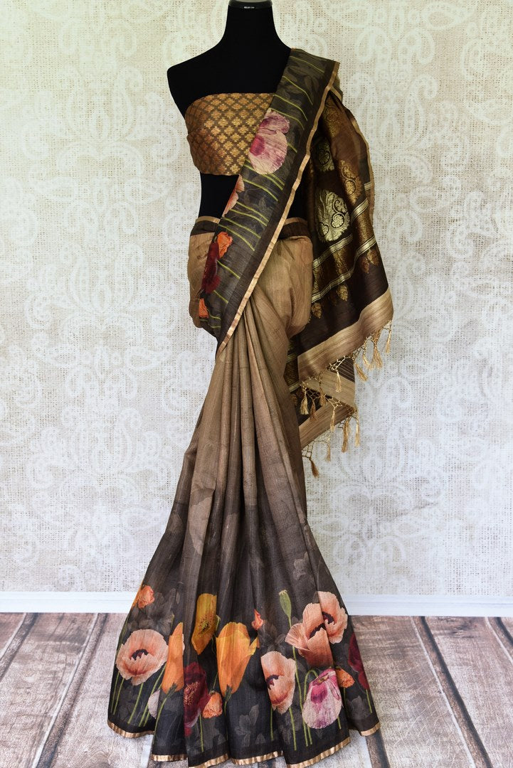 Elevate your professional look in this brown floral printed tussar silk saree. It features a beautiful banarsi blend and comes with a stunning designer buta work blouse. Shop handcrafted embroidery sarees, banarsi silk sari, ikkat sari online or visit Pure Elegance store, USA.-full view