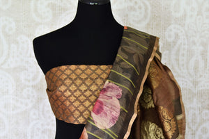 Elevate your professional look in this brown floral printed tussar silk saree. It features a beautiful banarsi blend and comes with a stunning designer buta work blouse. Shop handcrafted embroidery sarees, banarsi silk sari, ikkat sari online or visit Pure Elegance store, USA.-blouse pallu
