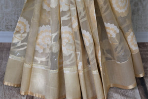 Shop online cream organza Banarasi sari in USA with floral design. Give your look an elegant touch with beautiful Indian designer saris available at Pure Elegance Indian fashion store in USA or shop online.-pleats