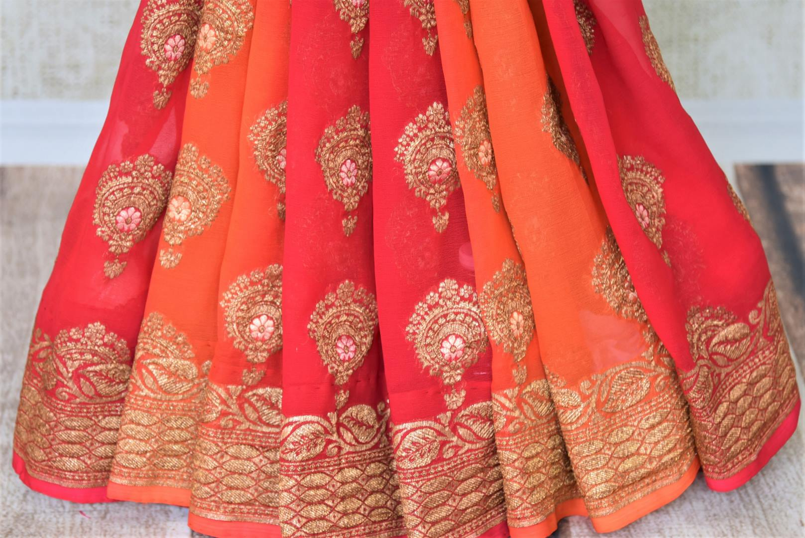 Buy online pink and orange georgette Banarasi saree in USA with floral design. Give your look an elegant touch with beautiful Indian sarees available at Pure Elegance Indian fashion store in USA or shop online.-pleats