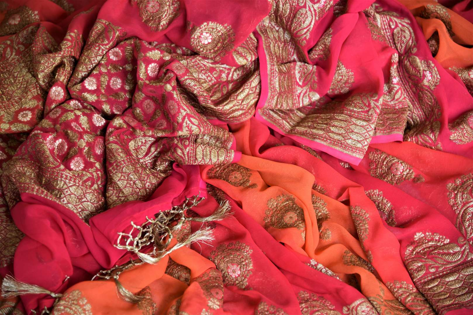 Buy online pink and orange georgette Banarasi saree in USA with floral design. Give your look an elegant touch with beautiful Indian sarees available at Pure Elegance Indian fashion store in USA or shop online.-details