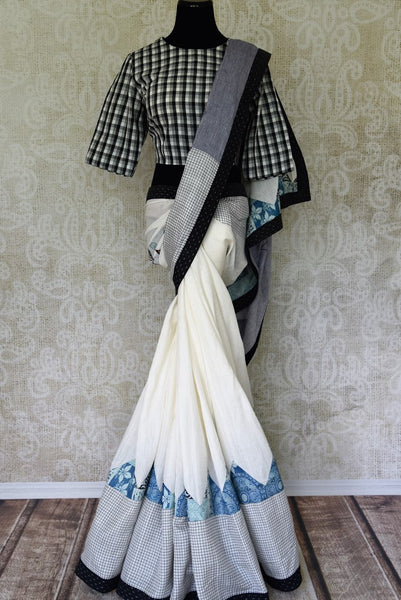 Buy online white linen sari with check saree blouse online in USA. Add tasteful Indian woven sarees to your ethnic wardrobe from Pure Elegance Indian fashion store in USA. We have an exclusive range of Indian designer sarees, wedding saris, handloom sarees to make your Indian look absolutely captivating.-full view