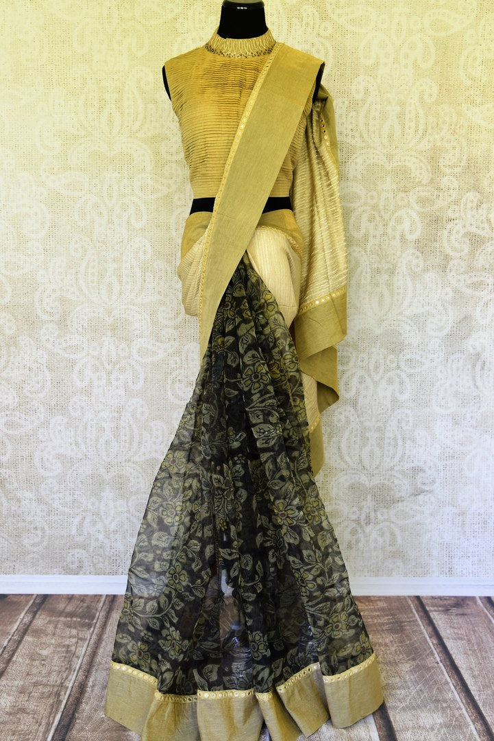 Buy black and gold tissue sari online in USA with Kalamkari applique. Add tasteful Indian woven saris to your ethnic wardrobe from Pure Elegance Indian fashion store in USA. We have an exclusive range of Indian designer sarees, wedding saris, handloom sarees to make your Indian look absolutely captivating.-full view