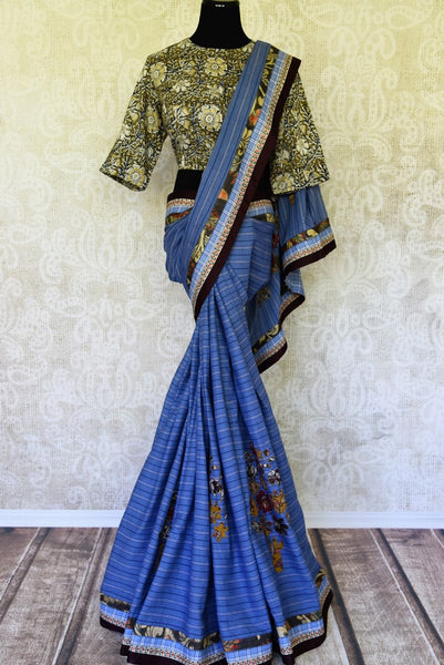 Buy blue linen sari with saree blouse online in USA and Kalamkari applique. Add tasteful Indian woven saris to your ethnic wardrobe from Pure Elegance Indian fashion store in USA. We have an exclusive range of Indian designer sarees, wedding saris, handloom sarees to make your Indian look absolutely captivating.-full view