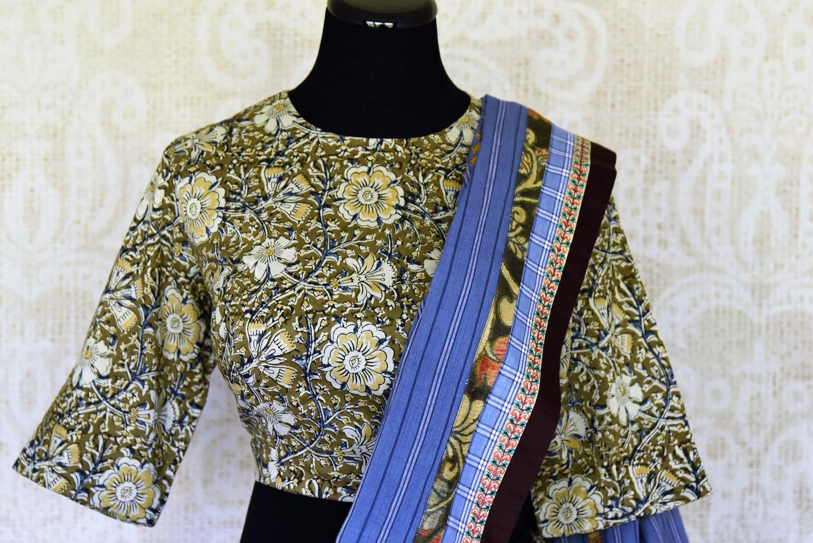 Buy blue linen sari with saree blouse online in USA and Kalamkari applique. Add tasteful Indian woven saris to your ethnic wardrobe from Pure Elegance Indian fashion store in USA. We have an exclusive range of Indian designer sarees, wedding saris, handloom sarees to make your Indian look absolutely captivating.-blouse pallu