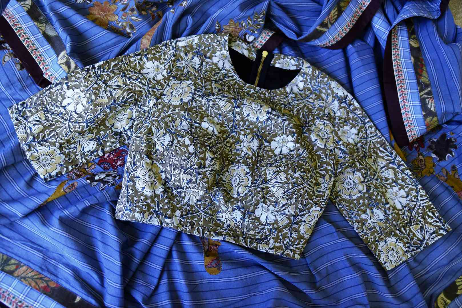 Buy blue linen sari with saree blouse online in USA and Kalamkari applique. Add tasteful Indian woven saris to your ethnic wardrobe from Pure Elegance Indian fashion store in USA. We have an exclusive range of Indian designer sarees, wedding saris, handloom sarees to make your Indian look absolutely captivating.-blouse