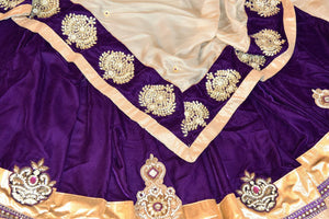 Shop designer purple embroidered shimmer saree online in USA. Shop more such exquisite Indian saris in USA from Pure Elegance. Get floored by a range of designer sarees, pure silk sarees, Kanchipuram silk saris at our Indian fashion store in USA.-details