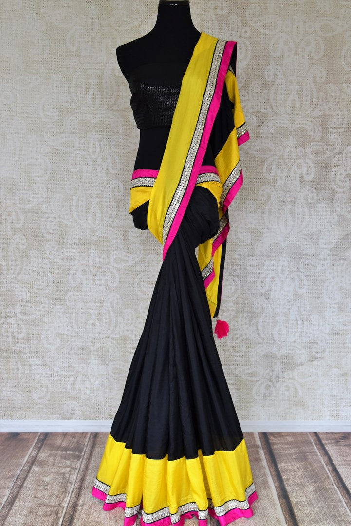 Shop black crepe sari online in USA with yellow border with silver embroidery. Elevate your traditional style with exquisite Indian designer sarees from Pure Elegance Indian clothing store in USA. Explore a range of stunning silk sarees, embroidered sarees, wedding sarees especially from India for women in USA.-full view