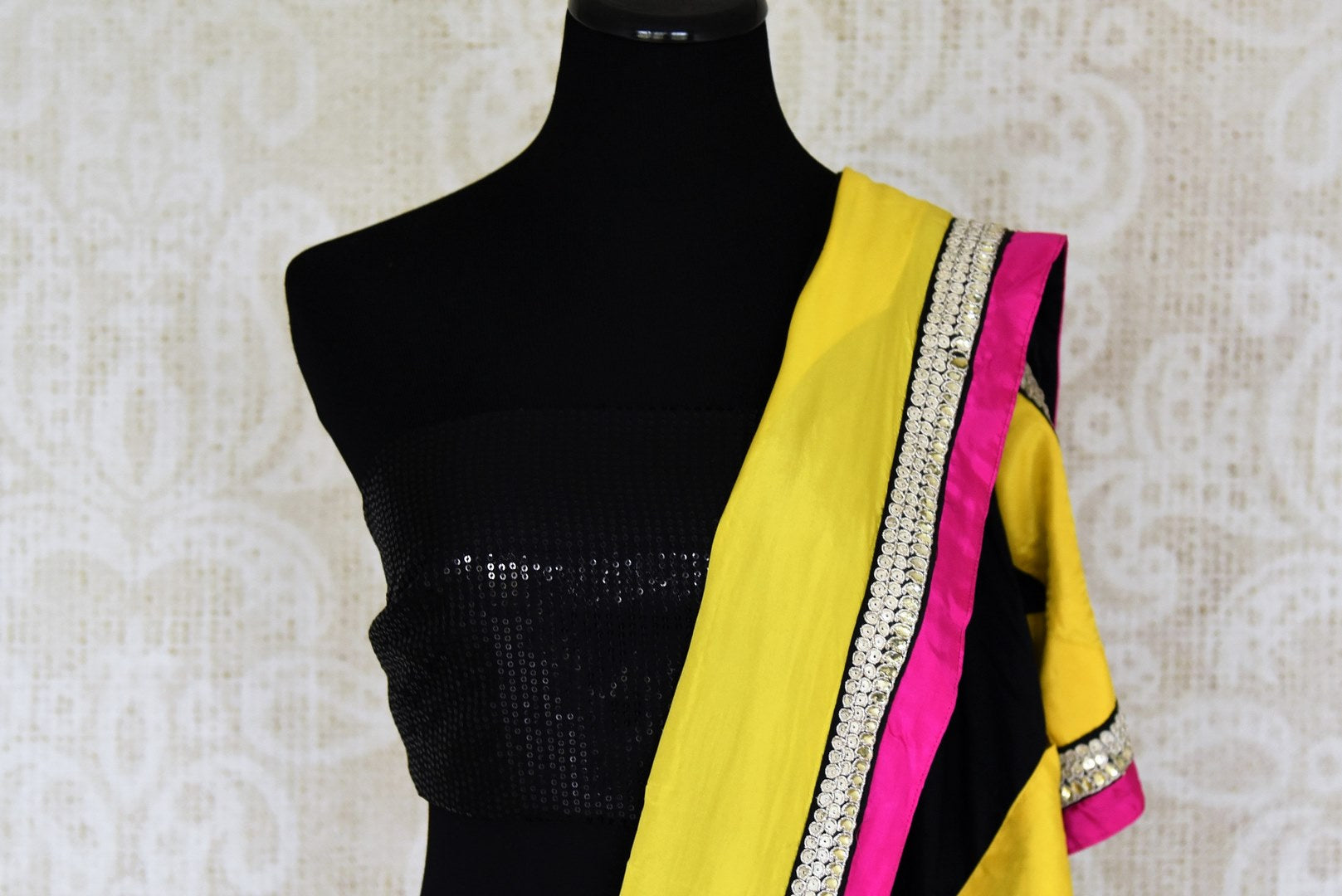Shop black crepe sari online in USA with yellow border with silver embroidery. Elevate your traditional style with exquisite Indian designer sarees from Pure Elegance Indian clothing store in USA. Explore a range of stunning silk sarees, embroidered sarees, wedding sarees especially from India for women in USA.-blouse pallu