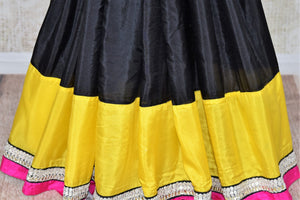 Shop black crepe sari online in USA with yellow border with silver embroidery. Elevate your traditional style with exquisite Indian designer sarees from Pure Elegance Indian clothing store in USA. Explore a range of stunning silk sarees, embroidered sarees, wedding sarees especially from India for women in USA.-pleats