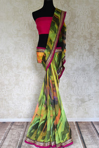 Buy beautiful green printed georgette saree online in USA with embroidered border. Shop the latest Indian women clothing and designer sarees for weddings and special occasions from Pure Elegance Indian clothing store in USA.-full view