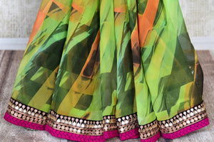 Buy beautiful green printed georgette saree online in USA with embroidered border. Shop the latest Indian women clothing and designer sarees for weddings and special occasions from Pure Elegance Indian clothing store in USA.-pleats