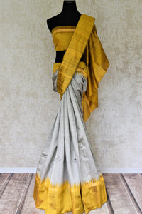 Buy grey tussar dupion silk sari online in USA with mustard yellow border. Add grace to your ethnic look with Indian designer silk sarees available at Pure Elegance Indian clothing store for women in USA or shop online.-full view