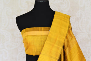 Buy grey tussar dupion silk sari online in USA with mustard yellow border. Add grace to your ethnic look with Indian designer silk sarees available at Pure Elegance Indian clothing store for women in USA or shop online.-blouse pallu