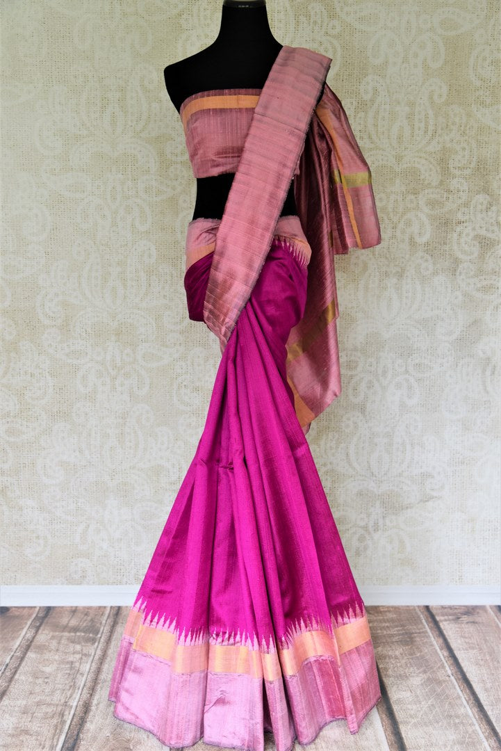 Buy bright magenta tussar dupion silk sari online in USA with mauve temple border. Shine in beautiful Indian designer silk saris available at Pure Elegance Indian clothing store for women in USA or shop online.-full view