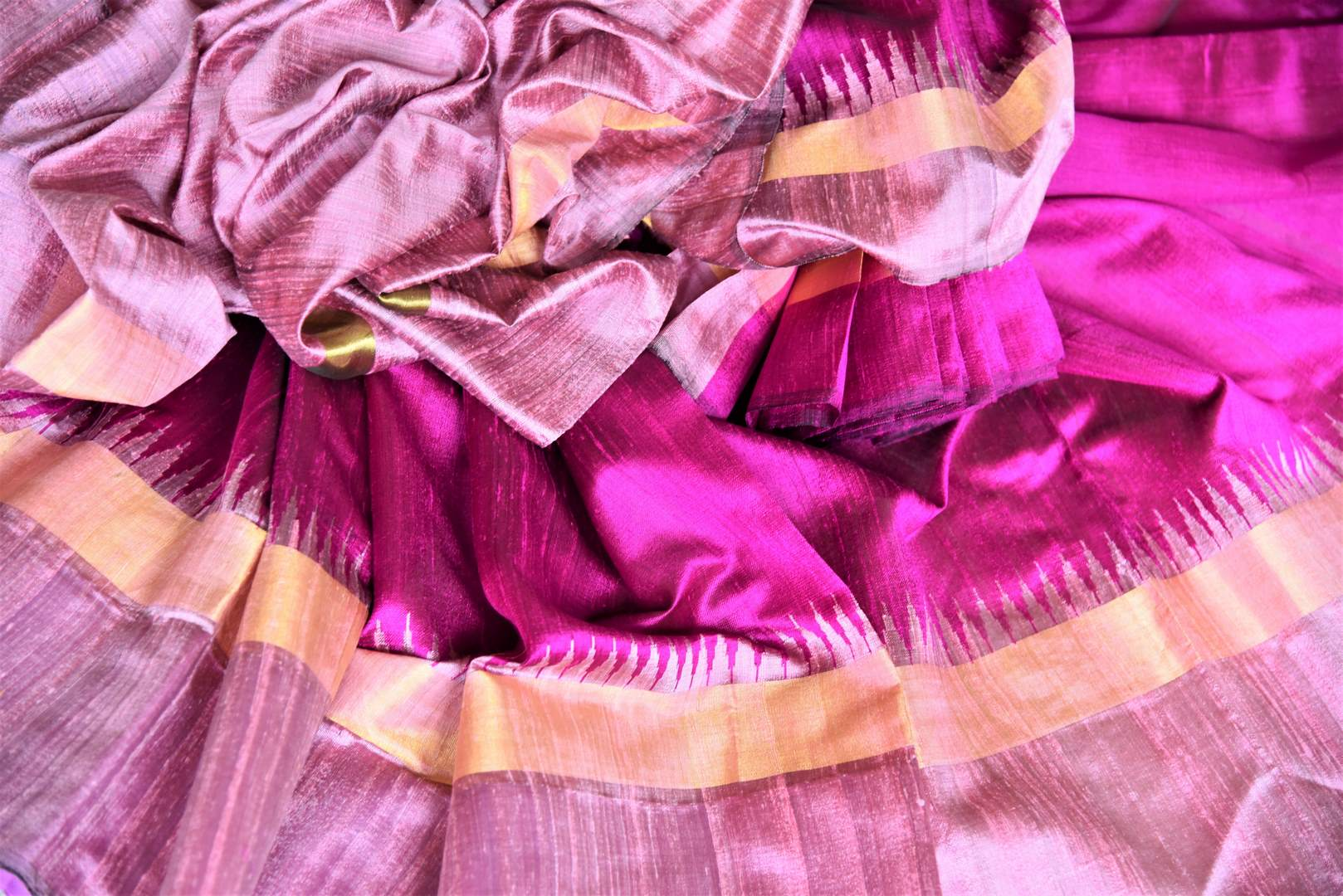 Buy bright magenta tussar dupion silk sari online in USA with mauve temple border. Shine in beautiful Indian designer silk saris available at Pure Elegance Indian clothing store for women in USA or shop online.-details