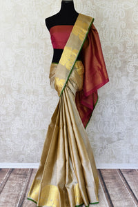 Buy traditional beige Kanjivaram silk saree online in USA with zari buta and maroon pallu. Make your Indian saree look rich with beautiful Indian Kanchipuram sarees from Pure Elegance Indian clothing in USA or shop online.-full view